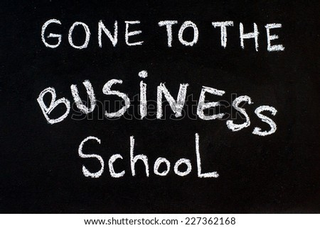 Gone to the business school message written with white chalk on blackboard, business learning concept - stock photo