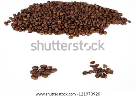 good and bad quality of coffee beans - stock photo