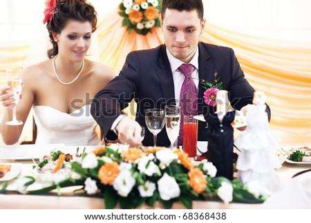 Good appetite. Husband taking food on wedding. - stock photo