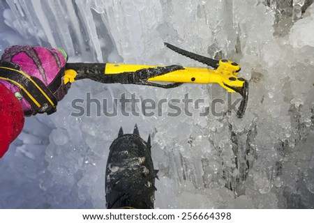 Good athlete provides the right equipment Safety and comfort on difficult mountain dangerous sections of the route in the cold winter on the background of the Alps and the beautiful wildlife - stock photo