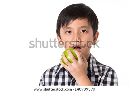 Good boy. Holding a green apple in hand. - stock photo