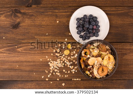 good breakfast, Organic Breakfast Quinoa with Nuts Milk and Berries, Breakfast oatmeal porridge with cinnamon, cranberries and blueberries, , selective focus, close up, top view - stock photo