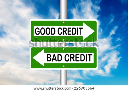 Good Credit and Bad Credit Road Signs with a blue sky in a background - stock photo