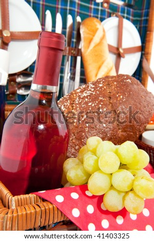 Good filled picnic basket with white grapes and wine for eating outdoor - stock photo