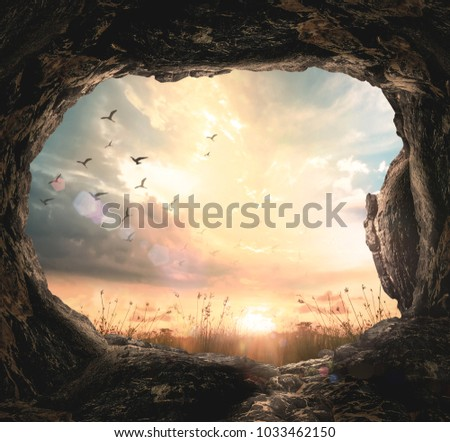 Good Friday Concept: Empty Tomb Stone And Meadow Sunrise Background