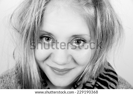 good girl with tousled hair looking straight into the camera - stock photo