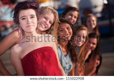 Good group of friends smiling together outdoors - stock photo