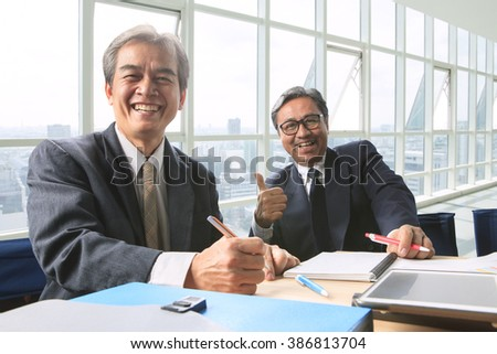 good healthy of couples friendship senior working man shot on office working table, happiness emotion ,laughing face - stock photo
