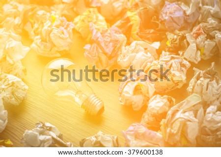 good idea and bad idea concept image symbol pf bulb and trash - stock photo
