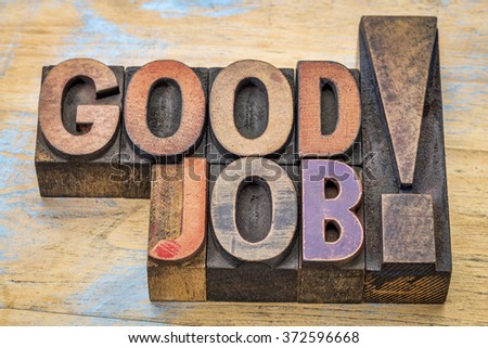 Good job compliment in vintage letterpress wood type printing blocks stained by color inks - stock photo