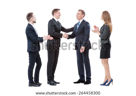 Good job! Partnership and congratulations.Two cheerful business men shaking hands while their colleagues applauding and smiling in the background. Isolated on white.