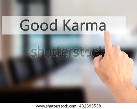 Good Karma - Hand pressing a button on blurred background concept . Business, technology, internet concept. Stock Photo - stock photo