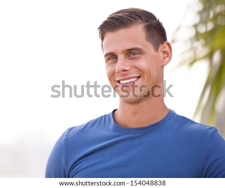 Good looking athletic Guy Smiling outside - stock photo