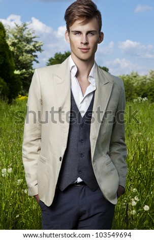 Good looking beautiful young man outdoor. - stock photo