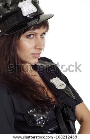 Good-looking brunette in a suit of police on a white background