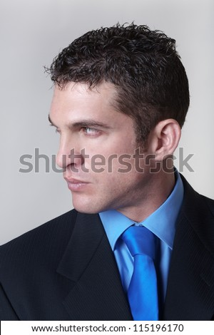 good looking business man looking to the side - stock photo