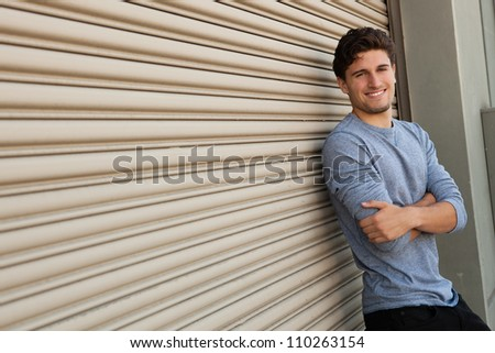 Good looking Caucasian male outdoors in urban setting. - stock photo