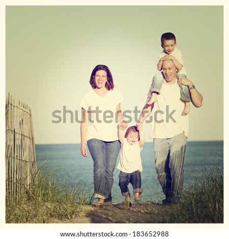 Good looking family going for a walk at the beach at sunset with Instagram effect filter - stock photo