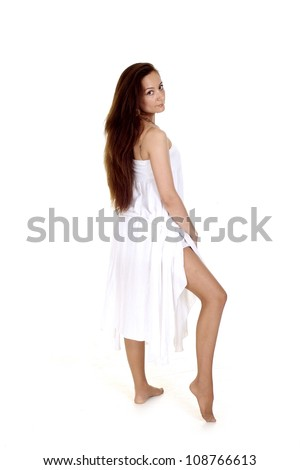 Good-looking girl in a pretty white dress oa white background