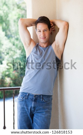 Good looking guy in tank top and jeans