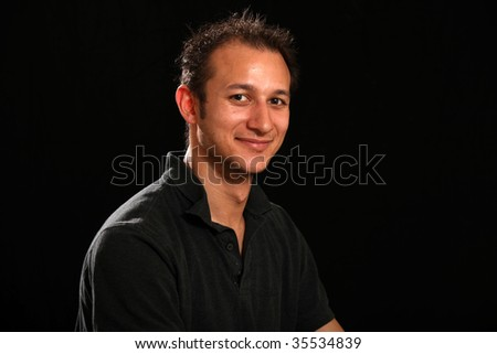 Good Looking Handsome Young Man in a Studio Setting - stock photo