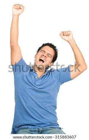 Good looking latino man in blue casual clothes, eyes closed, celebrating a winning team or goal or event by raising arms and pumping fists expressing ecstasy, happiness