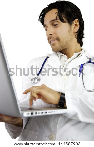 Good looking male doctor serious working