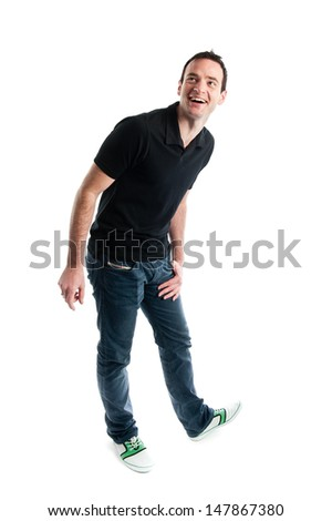 Good looking man posing in a studio environment - stock photo