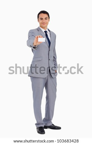 Good-looking man showing his business card against white background