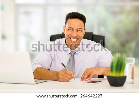 good looking mid age business executive working in office