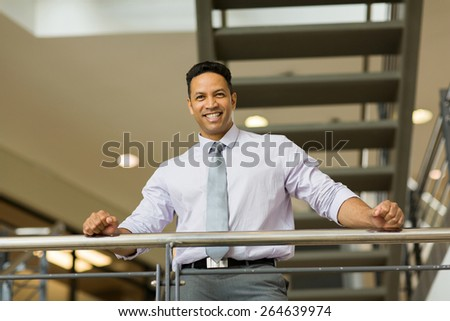 good looking mid age corporate worker in modern office - stock photo