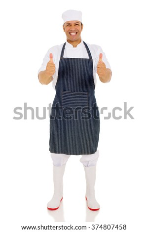 good looking middle aged chef giving thumbs up - stock photo
