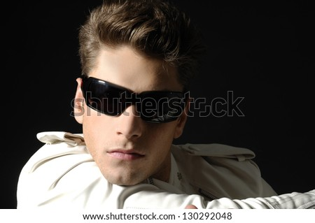 Good looking modern young man with sunglasses