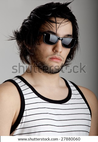 Good looking modern young man with sunglasses - stock photo