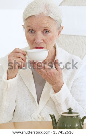 good looking senior having a cup of tea