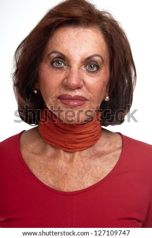 Good looking senior woman. Dressed in red. Isolated.