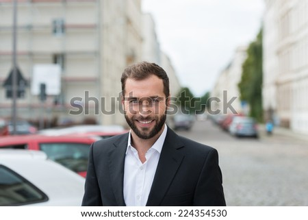 Good Looking Smiling Handsome Middle Age Man at Car Parking Area Along the Street - stock photo