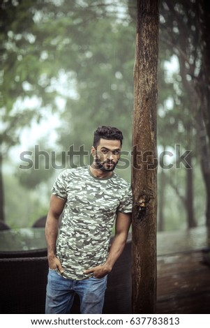 Good looking well built gym fit muscled fitness model outdoors in the Woods with morning fog