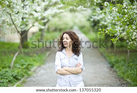 Good looking woman in a spring garden