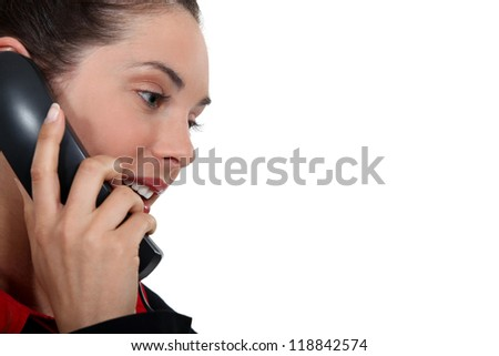 good-looking woman on the phone - stock photo