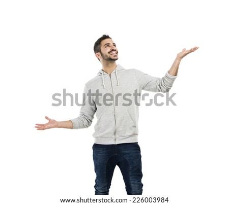 Good looking young man catching something with is hands, with copy-space for the designer - stock photo