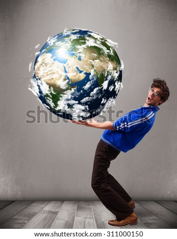 Good-looking young man holding 3d planet earth - stock photo