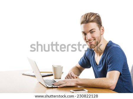 Good looking young man in the office working, isolated over white background  - stock photo