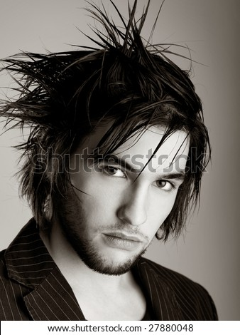 Good looking  young man with modern HairStyle - toned in PS - stock photo