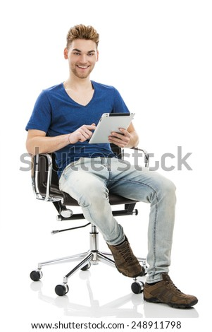 Good looking young man working on a tablet, isolated on white background - stock photo