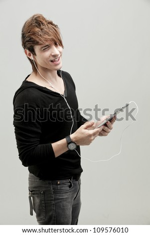 Good Looking Young Smart Guy Man Using Tablet Computer