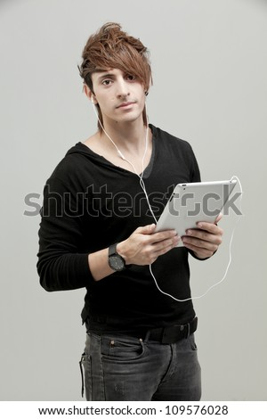 Good Looking Young Smart Guy Man Using Tablet Computer - stock photo