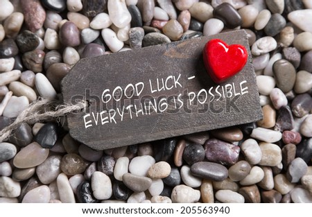 Good luck and everything is possible: greeting card with red heart for courage and convalescence. - stock photo