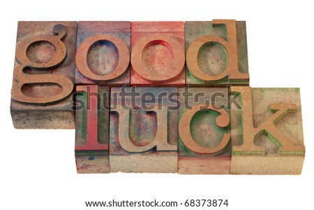 good luck- phrase  in vintage wooden letterpress printing blocks, stained with color inks, isolated on white