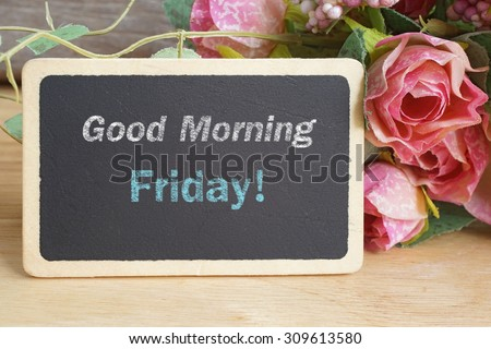 Good Morning Friday word on chalkboard with roses bouquet - stock photo